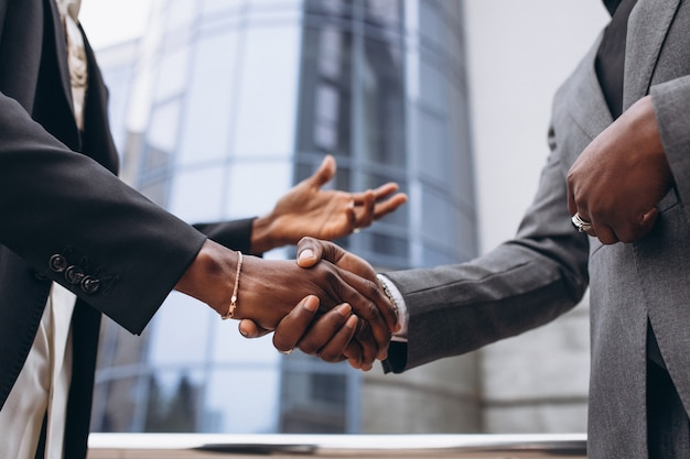African business male people shaking hands Free Photo