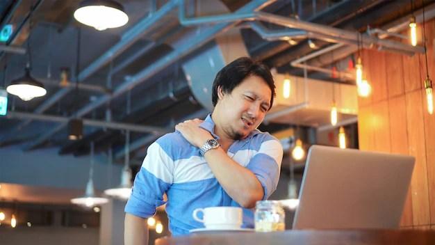 Asian businessman working with neck pain, backache, headache