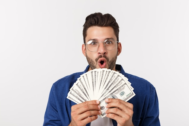 Attractive man is holding cash money in one hand, on isolated ...