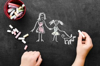 Chalk drawing with single mother Free Photo