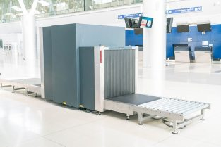 Check baggage at the airport x-ray scanner Free Photo