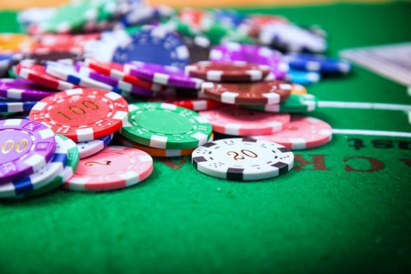 Premium Photo   Chips of colored casinos placed on the green table are  coins that are used to bet in casin
