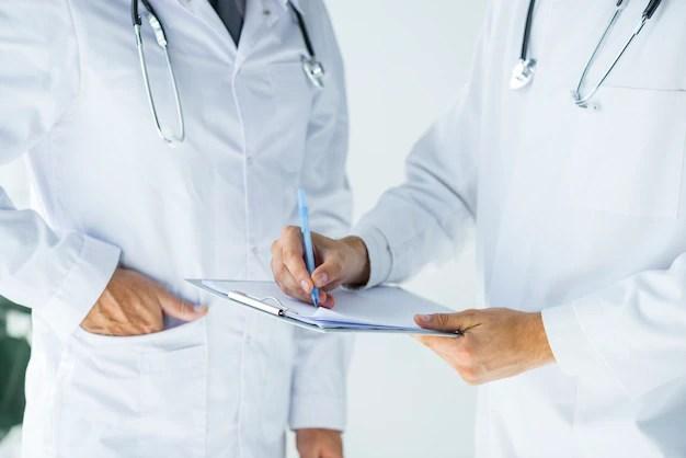 Doctors making a medical document