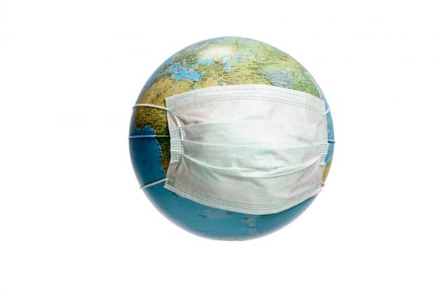 Earth globe with protective mask   Premium Photo