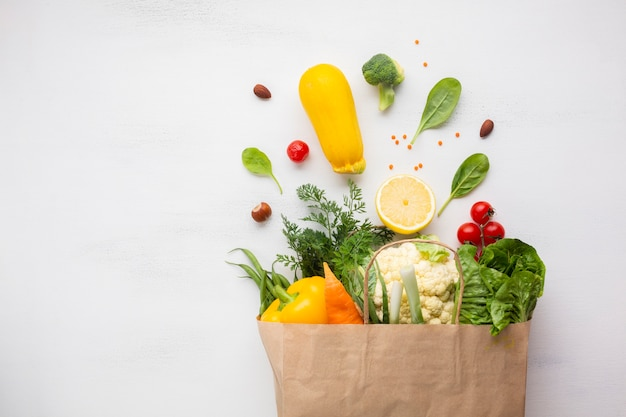 Flat lay of bag of groceries Free Photo