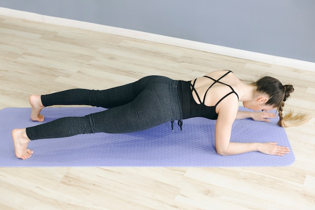 From above woman in plank pose Free Photo