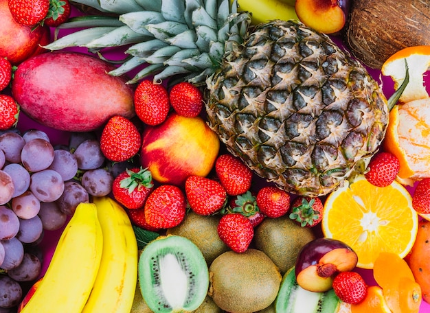 Grapes; strawberries; pineapple; kiwi; apricot; banana and whole pineapple Free Photo