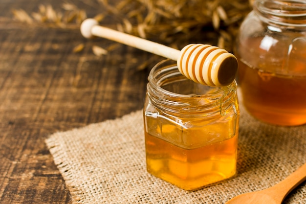 Honey spoon on jar Premium Photo