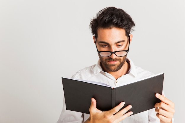 Free Photo | Intellectual man reading with glasses