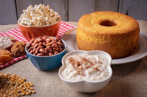 June party. typical sweets from festa junina. cornmeal cake, popcorn, hominy, cocada, pumpkin jam, and peanuts Premium Photo