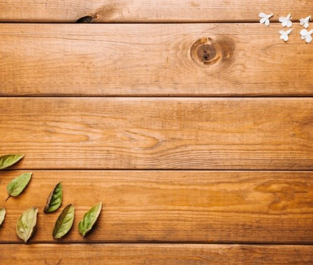 Leaves And Petals On Wooden Tabletop Photo