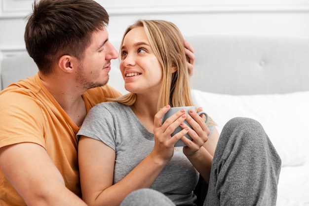 Free Photo | Medium shot happy couple with coffee in bed