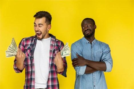 Men with dollar bills Free Photo