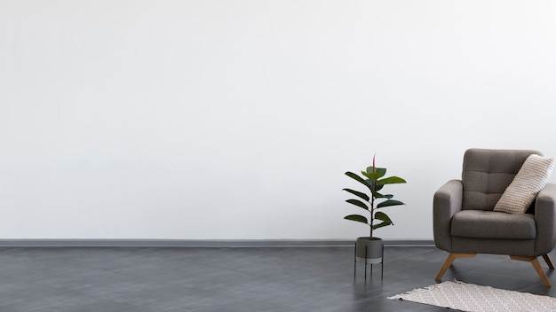 Minimalist living room design with armchair and plant Free Photo