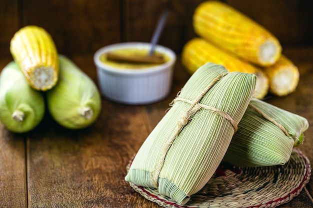 Pamonha, brazilian sweet corn wrapped in dry straw, made for june rural parties Premium Photo
