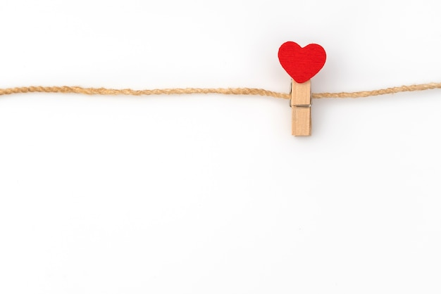 Red Paper Heart Hanging On White Background Photo Free