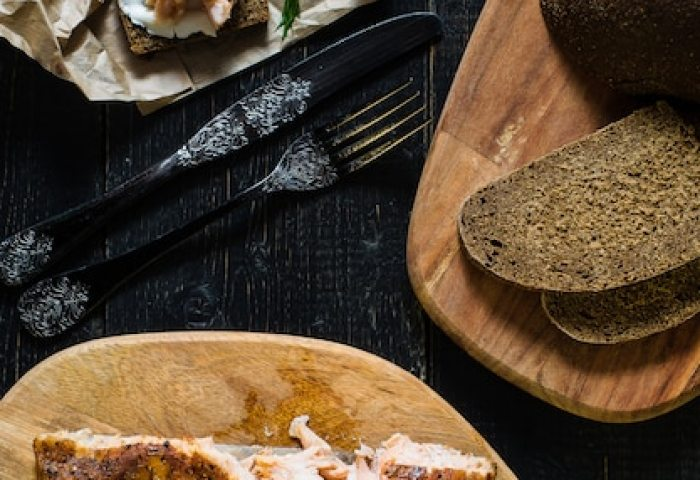 Scandinavian Sandwich With Smoked Salmon Fillet On Black Bread With