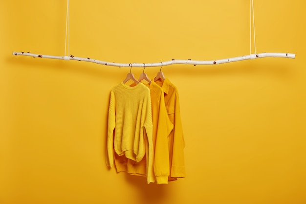 hangers long sleeved yellow jumpers