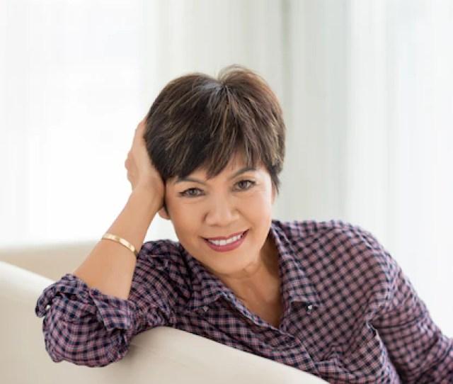 Smiling Mature Asian Woman Premium Photo