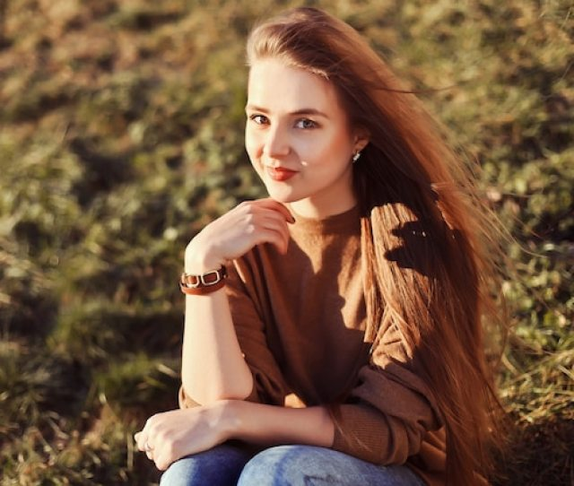 Teen Girl With Long Hair Sitting On The Grass Free Photo