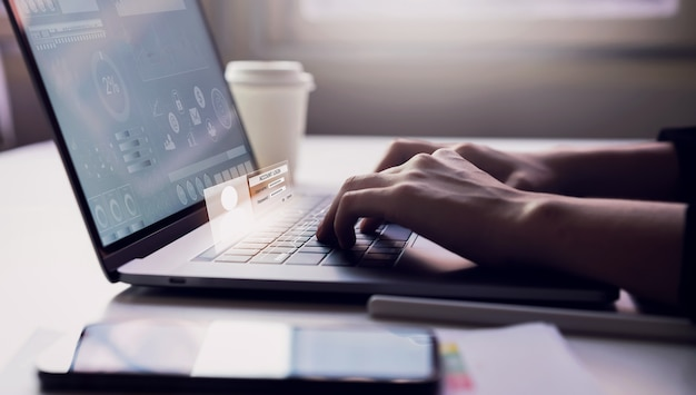Premium Photo | Woman typing keyboard laptop and account login screen on the working in the office on table background. safety concepts about internet use.