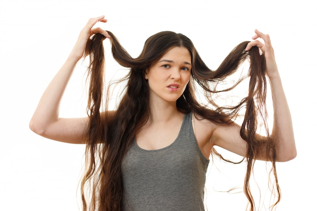 Young woman with problem hair. on white isolated Premium Photo