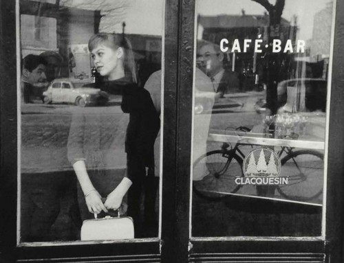 1957---Edouard-Boubat,-Waiting-for-a-date-at-the-Café-Vache-Noir,-Paris
