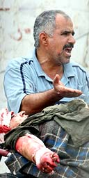 A man shouts for help in Yarmouk hospital, Baghdad