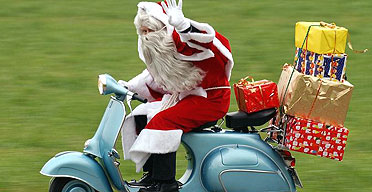 Santa delivers presents on a Vespa scooter