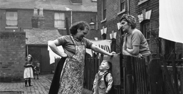 Neighbours chat in Birmingham, 1954