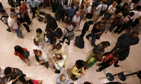 Passengers in line at Heathrow airport