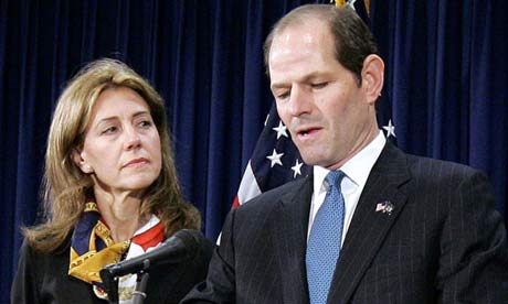 Eliot Spitzer announces his resignation amid a prostitution scandal as wife Silda looks on. Photograph: Stephen Chernin/AP