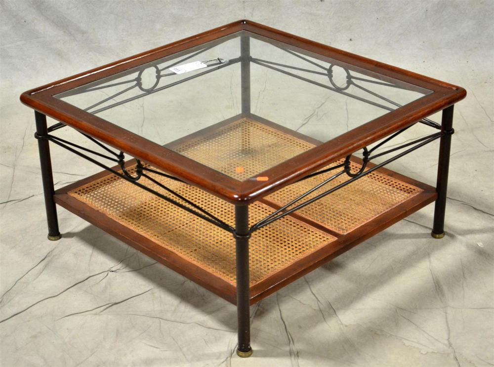 contemporary glass top caned coffee table glass insert over caned lower shelf metal legs and decoration around sides 19 h x 35