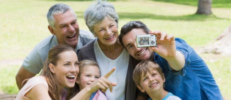 Man clicking a picture with family