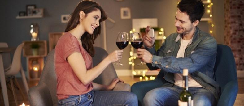 Romantic couple raising a toast
