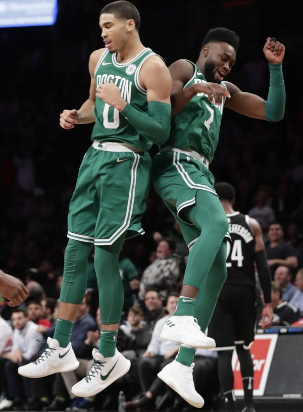 Boston Celtics' Jayson Tatum (0) and Jaylen Brown (7) celebrate after Tatum scored during the second half of an NBA basketball game against the Brooklyn Nets Tuesday, Nov. 14, 2017, in New York. The Celtics won 109-102.