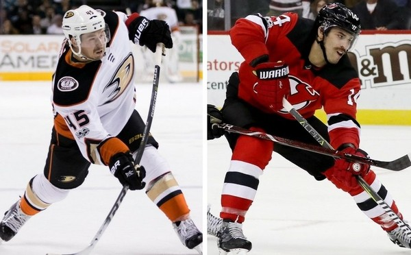 The Devils acquired defenseman Sami Vatanen (left) from the Ducks in exchange for a package which included Adam Henrique. (USA TODAY and Getty Images)