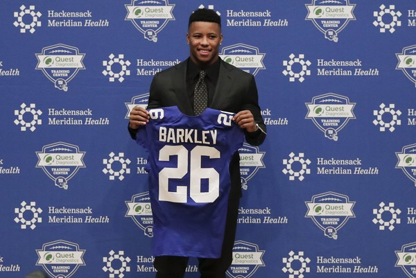 Running back Saquon Barkley poses for photos during a news conference, Saturday, April 28, 2018, in East Rutherford, N.J. Barkley was selected as the number two overall pick in the NFL football draft by the New York Giants. (AP Photo/Julie Jacobson)