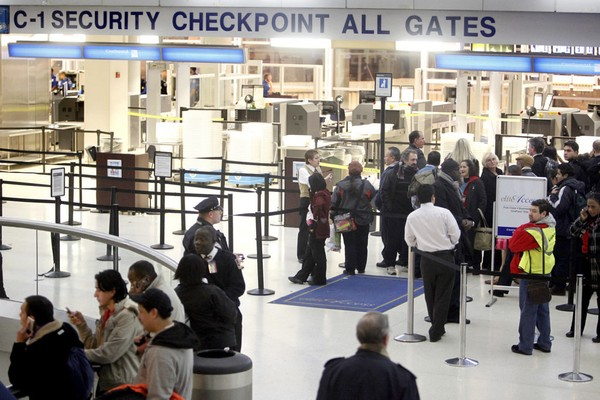 Seven members of a television crew have been charged by cops with trying to sneak a fake explosive device through a security checkpoint at Newark Airport, the Transportation Security Administration said.