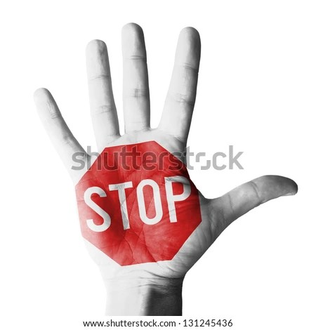 Hand raised with stop sign painted - isolated on white background - stock photo