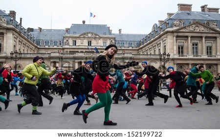 PARIS - DECEMBER 9: People dance at Palais Royal square on December 9, 2012 in Paris, France. This flash mob is held in memory of famous dancer Dominique Bagouet. - stock photo