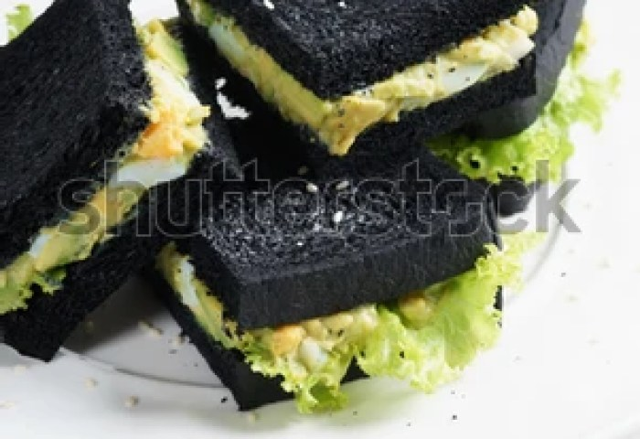 Sandwich Of Black Charcoal Bread With Egg And Avocado For Healthy