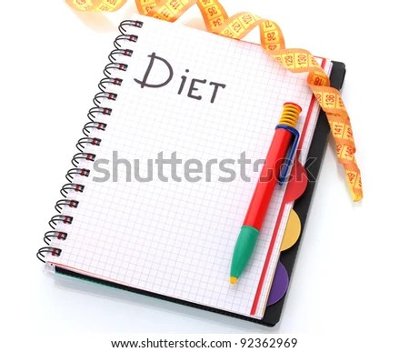 stock photo : Planning of diet. Notebook measuring tape and pencil isolated on white