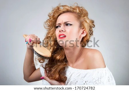 b stuck in curly hair stock photo shutterstock