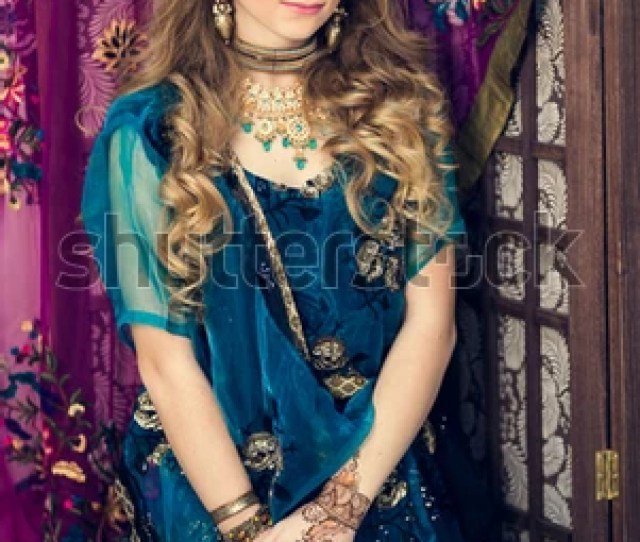 Portrait Of A Beautiful Girl In Blue Indian Traditional Dress With Her Hands Painted With