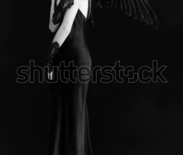 A Woman Dressed As An Evil Angel
