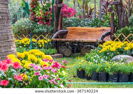 Free photos Wood chair in the flowers garden   Flowers in the garden     Wood chair in the flowers garden   Flowers in the garden   387140224