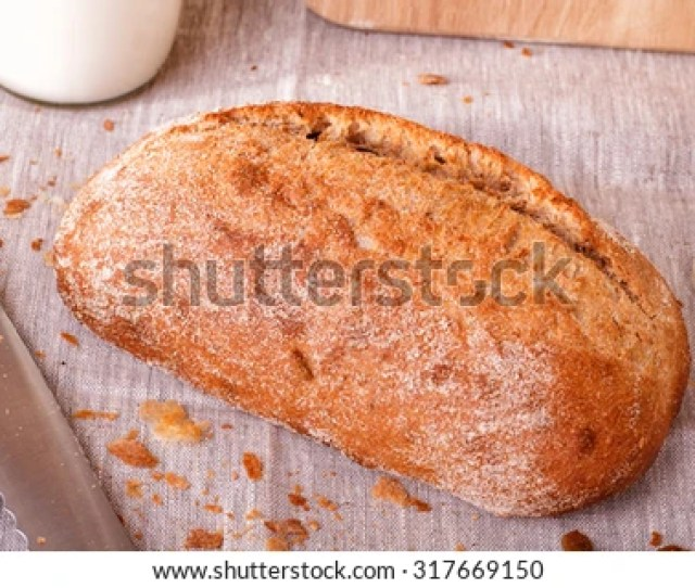 Oblong Is A Well Toasted Bread On The Tablecloth Homemade Bread A Bottle