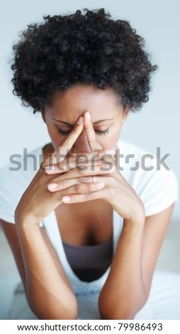 Portrait of African American woman suffering from illness or headache - stock photo