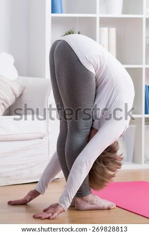 Picture of stretched mature lady bending down